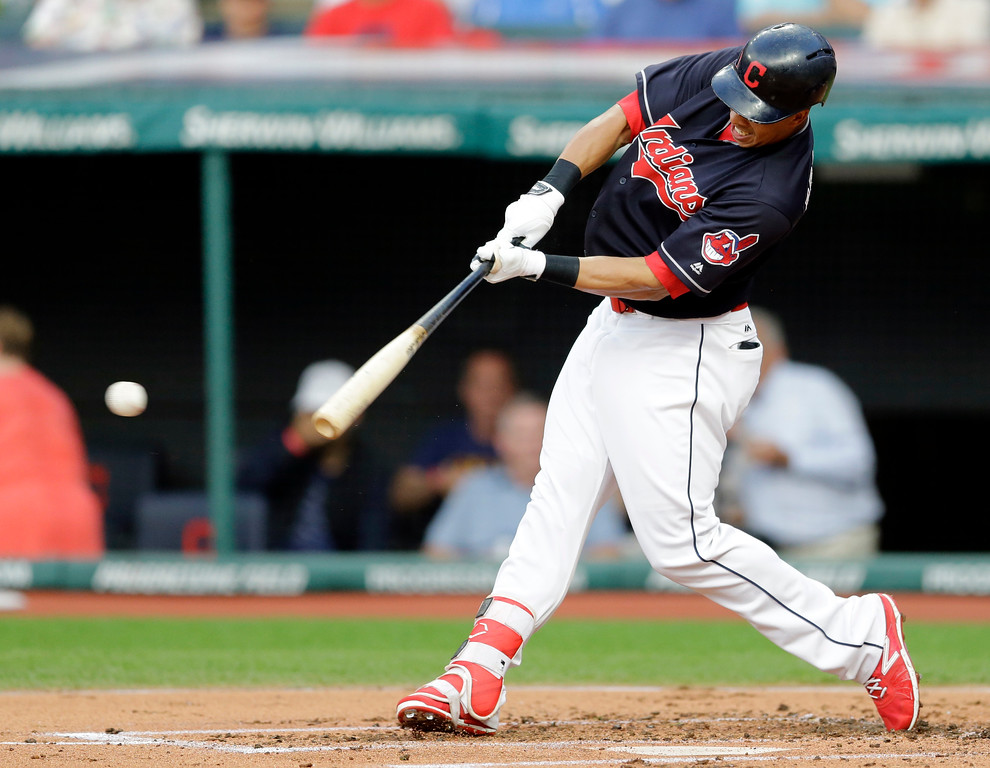 . Cleveland Indians\' Michael Brantley hits a double off Los Angeles Dodgers starting pitcher Brandon McCarthy in the first inning of an interleague baseball game, Wednesday, June 14, 2017, in Cleveland. (AP Photo/Tony Dejak)