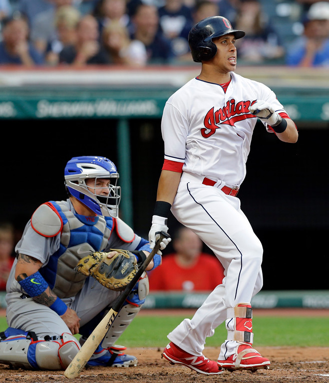 . Cleveland Indians\' Michael Brantley watches his RBI single off Los Angeles Dodgers starting pitcher Clayton Kershaw during the third inning of a baseball game, Tuesday, June 13, 2017, in Cleveland. (AP Photo/Tony Dejak)