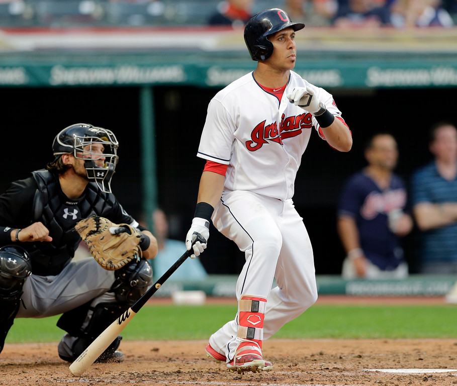 . Cleveland Indians\' Michael Brantley watches his ball after hitting a double off Chicago White Sox starting pitcher David Holmberg in the fourth inning of a baseball game, Saturday, June 10, 2017, in Cleveland. Chicago White Sox catcher Kevan Smith watches. (AP Photo/Tony Dejak)