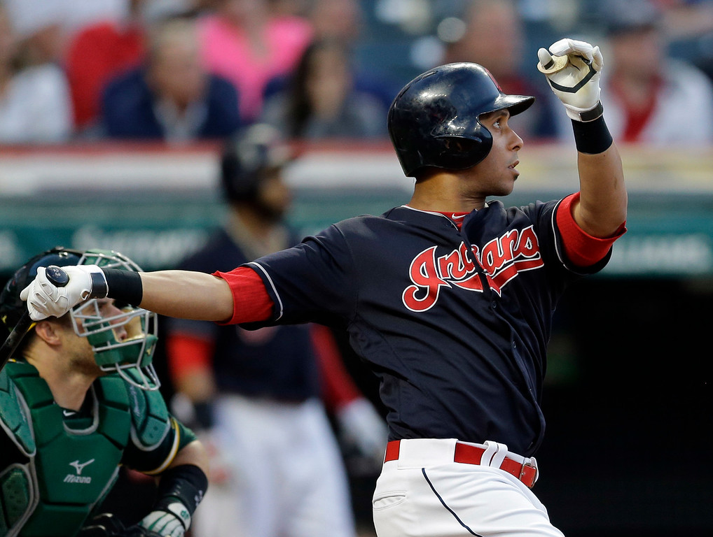 . Cleveland Indians\' Michael Brantley watches his ball after hitting against Oakland Athletics relief pitcher Santiago Casilla in the ninth inning of a baseball game, Wednesday, May 31, 2017, in Cleveland. Brantley was safe at second base on an error by Khris Davis. The Athletics won 3-1. (AP Photo/Tony Dejak)