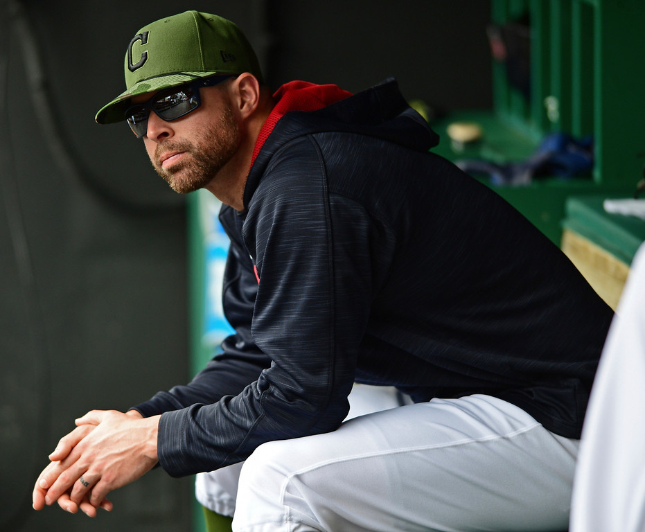. Cleveland Indians starting pitcher Corry Kluber sits int he dugout in the seventh inning of a baseball game against the Kansas City Royals, Sunday, May 28, 2017, in Cleveland. The Indians won 10-1. (AP Photo/David Dermer)