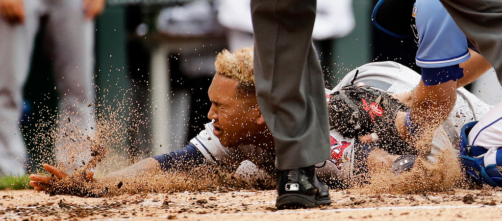 . Cleveland Indians\' Jose Ramirez is tagged out at home by Kansas City Royals catcher Drew Butera as he tried to score on a double by Austin Jackson during the fourth inning of a baseball game Sunday, June 4, 2017, in Kansas City, Mo. (AP Photo/Charlie Riedel)