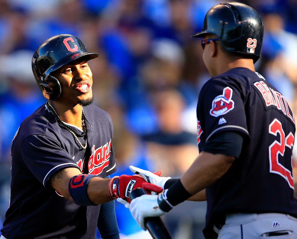 . Cleveland Indians Francisco Lindor (12) is congratulated by teammate Michael Brantley (23) following his solo, back-to-back home during the ninth inning of a baseball game against the Kansas City Royals at Kauffman Stadium in Kansas City, Mo., Saturday, May 6, 2017. The Indians defeated the Royals 3-1. (AP Photo/Orlin Wagner)