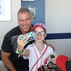 Tim Phillis - The News-Herald<br /> Joe Charboneau with a fan on Aug. 6 at Classic Park.