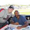 Tim Phillis - The News-Herald<br /> Hanford Dixon with a fan on Aug. 6 at Classic Park.