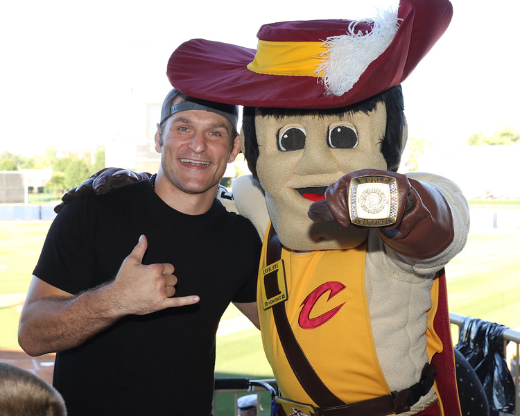 Tim Phillis - The News-Herald<br /> Stipe Miocic and Cavaliers mascot Sir CC on Aug. 6 at Classic Park.