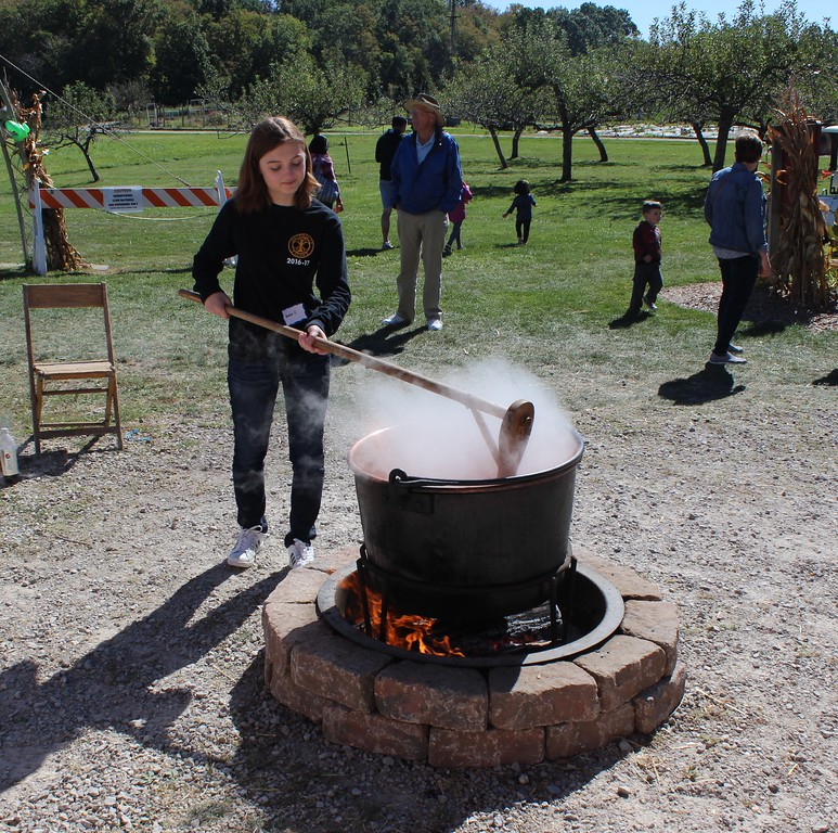 . Tawana Roberts - The News-Herald <br> Volunteer Grace Carter, 17, stirs apple butter at the Lake Metroparks Farmpark Apple Butter and Cider Festival on Oct. 1.