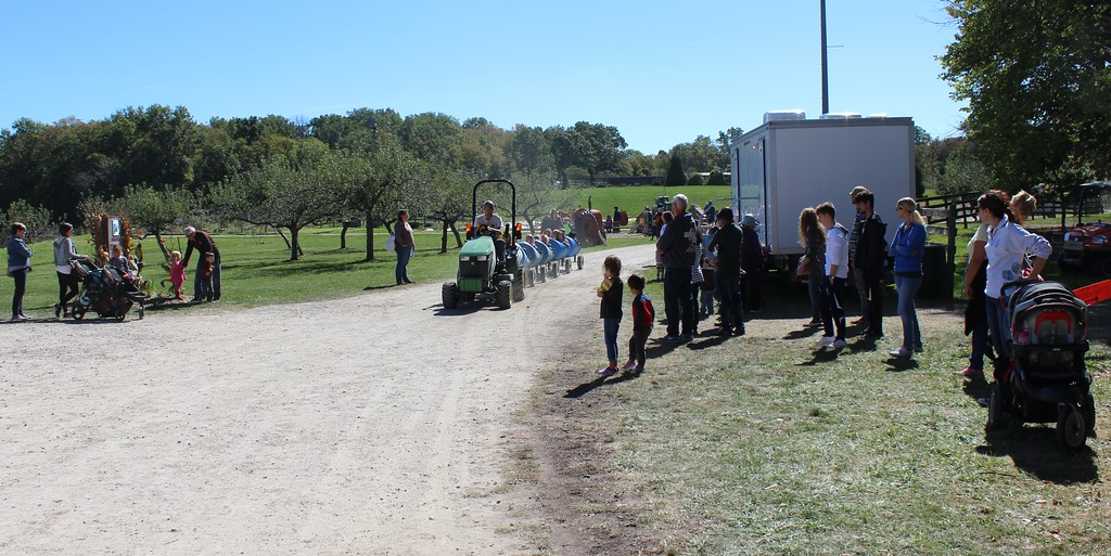 . Tawana Roberts - The News-Herald <br> Visitors enjoy a tractor-pulled wagon on Oct. 1 at the Lake Metroparks Farmpark Apple Butter and Cider Festival.