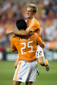 Houston Dynamo Stuart Holden helps Brian Ching celebrate a late frist half goal as the Houston Dynamo battled the Colorado Rapids May 10.  The Dynamo defeated the Rapids 2-1 for their first victory of the 2008 season.