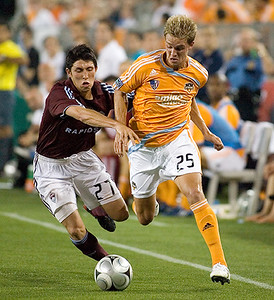 Stuart Holden battles for the ball early in the second half.  The Houston Dyanamo hosted the Colorado Rapids May 10 looking for their first victory of the season.  Wearing Brian Ching's shorts in the second half may have brought good fortune to Holden and the Dynamo, as Houston defeated Colorado 2-1.