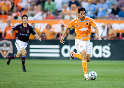 Brian Ching races to score an unguarded goal late in the first half to give the Houston Dynamo a 1-0 lead against the Colorado Rapids.  The defending MLS champions defeated the Rapids 2-1 for their first victory of the season May 10, 2008 in Houston, Texas.