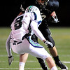 Monarch High School's Britt Shields (18) avoids a tackle by Standley Lake High School's Jay Polachek (8) during their game at Centaurus High School in Louisville Friday, Oct. 2, 2009.<br /> KASIA BROUSSALIAN / THE CAMERA