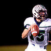 Standley Lake High School's QB Koltin Fatzinger (15) looks for an opening to throw the ball before he is tackled by Monarch High School defense during their game at Centaurus High School in Louisville Friday, Oct. 2, 2009.<br /> KASIA BROUSSALIAN / THE CAMERA