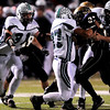 Monarch High School's Christian Bautista (27) is taken down by Standley Lake High School's Nick Pollock (63) and Anthony Payne (37) during their game at Centaurus High School in Louisville Friday, Oct. 2, 2009.<br /> KASIA BROUSSALIAN / THE CAMERA