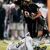 Monarch High School's Britt Shields (18) narrowly avoids another tackle by Standley Lake High School's Jay Polachek (8) during their game at Centaurus High School in Louisville Friday, Oct. 2, 2009.<br /> KASIA BROUSSALIAN / THE CAMERA