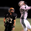 Monarch High School's Chad Elder (27) misses the catch as Standley Lake High School's Jay Polachek (8) intercepts during their game at Centaurus High School in Louisville Friday, Oct. 2, 2009.<br /> KASIA BROUSSALIAN / THE CAMERA