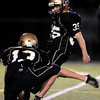 Monarch High School's Jordan Brungardt (35) kicks an extra point after their first touchdown against Standley Lake High School at Centaurus High School in Louisville Friday, Oct. 2, 2009.<br /> KASIA BROUSSALIAN / THE CAMERA