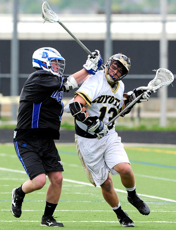 """The Monarch Coyote's Connor Eakes (13) bangs with Alexander Dawson's Robby Keown  (1) during their game at Monarch High on Wednesday April 25, 2012.  For more photos of the game go to  <a href=""""http://www.bocopreps.com"""">http://www.bocopreps.com</a><br /> Photo by Paul Aiken"""