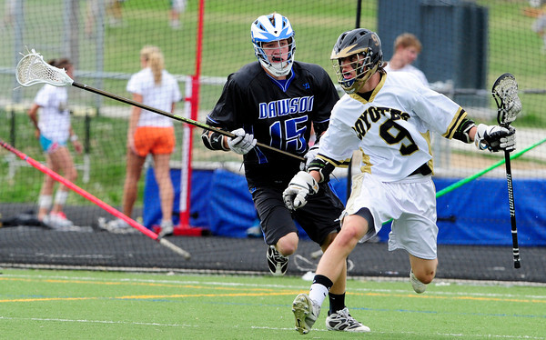 """The Monarch Coyote's Taylor Buderus (9) takes the ball downfield as Alexander Dawson's Scott Rutherford (15) defends during their game at Monarch High on Wednesday April 25, 2012.  For more photos of the game go to  <a href=""""http://www.bocopreps.com"""">http://www.bocopreps.com</a><br /> Photo by Paul Aiken"""