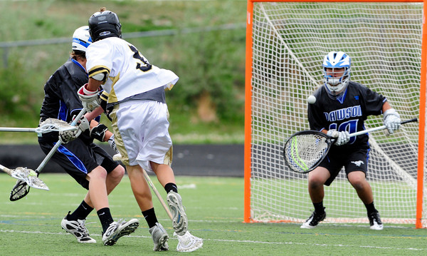 "The Monarch Coyote's Max Weisner (5) shoots on Alexander Dawson's Goalie Danny Weiss (10) during their game at Monarch High on Wednesday April 25, 2012.  For more photos of the game go to  <a href=""http://www.bocopreps.com"">http://www.bocopreps.com</a><br /> Photo by Paul Aiken"