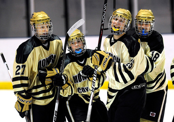 """Monarch High School Hockey Team's from left to right Everett Freske, (27) Joey Buchan (17) Thomas Evans (26) and David Neitenbach (18) celebrate a goal against Dakota Ridge during their game at the Boulder Valley Ice rink in Superior on Monday January 23, 2012. For more photos and a recap of the game go to  <a href=""""http://www.bocopreps.com"""">http://www.bocopreps.com</a>. <br /> Photo by Paul Aiken"""