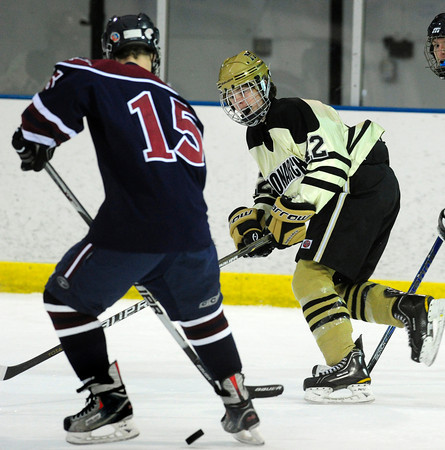 """Monarch High School Hockey Team's Cameron Taggart (42) waits for a pass through Dakota Ridge's Blake Davies (15)  during their game at the Boulder Valley Ice rink in Superior on Monday January 23, 2012. For more photos and a recap of the game go to  <a href=""""http://www.bocopreps.com"""">http://www.bocopreps.com</a>. <br /> Photo by Paul Aiken"""