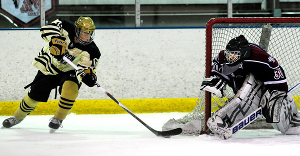 "Monarch High School Hockey Team's Dmitri Kyle (15) drives toward the net as Dakota Ridge's goalie Cody Giles (30) blocks the net  during their game at the Boulder Valley Ice rink in Superior on Monday January 23, 2012. For more photos and a recap of the game go to  <a href=""http://www.bocopreps.com"">http://www.bocopreps.com</a>. <br /> Photo by Paul Aiken"