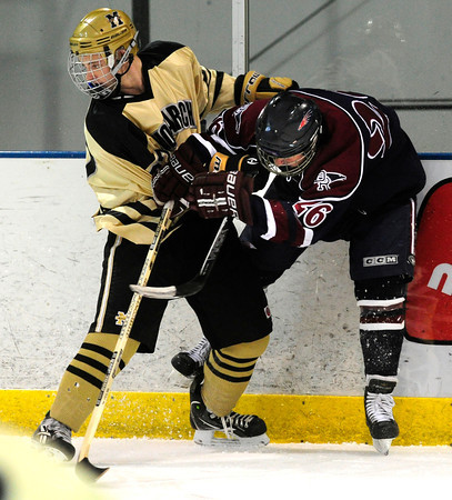 """Monarch High School Hockey Team's Everett Freske (27) tangles with Dakota Ridge's Zach Czarnecki (26) during their game at the Boulder Valley Ice rink in Superior on Monday January 23, 2012. For more photos and a recap of the game go to  <a href=""""http://www.bocopreps.com"""">http://www.bocopreps.com</a>. <br /> Photo by Paul Aiken"""