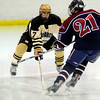 """Monarch High School Hockey Team's Zach Milavitz (7) defends the net against Dakota Ridge's Riley Konsella (21) during their game at the Boulder Valley Ice rink in Superior on Monday January 23, 2012. For more photos and a recap of the game go to  <a href=""""http://www.bocopreps.com"""">http://www.bocopreps.com</a>. <br /> Photo by Paul Aiken"""