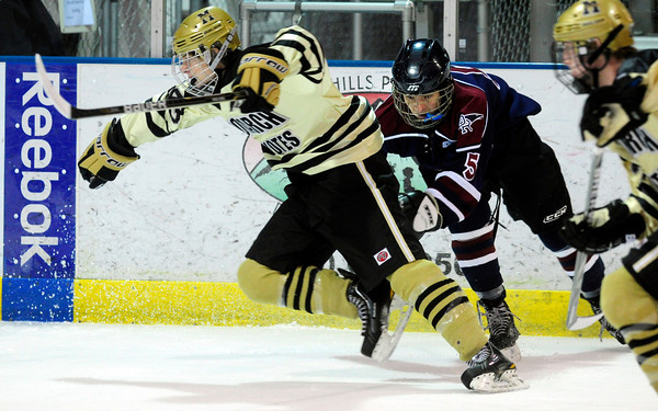 """Monarch High School Hockey Team's  Cameron Taggart (42) gets tangled up with Dakota Ridge's Patrick Roy (5) during their game at the Boulder Valley Ice rink in Superior on Monday January 23, 2012. For more photos and a recap of the game go to  <a href=""""http://www.bocopreps.com"""">http://www.bocopreps.com</a>. <br /> Photo by Paul Aiken"""