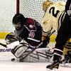 "Monarch High School Hockey Team's Noah Zimmerman (2) jams the puck in against Dakota Ridge's Goalie Cody Giles (30) during their game at the Boulder Valley Ice rink in Superior on Monday January 23, 2012. For more photos and a recap of the game go to  <a href=""http://www.bocopreps.com"">http://www.bocopreps.com</a>. <br /> Photo by Paul Aiken"