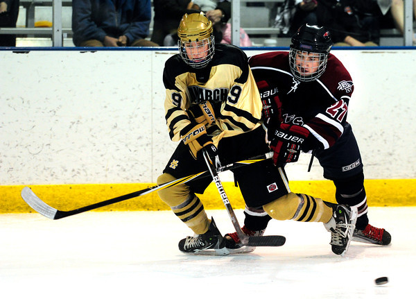 """Monarch High School Hockey Team's Walker Harris (9) tangles with Dakota Ridge's Wyatt Knese (27) during their game at the Boulder Valley Ice rink in Superior on Monday January 23, 2012. For more photos and a recap of the game go to  <a href=""""http://www.bocopreps.com"""">http://www.bocopreps.com</a>. <br /> Photo by Paul Aiken"""