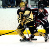 "Monarch High School Hockey Team's Walker Harris (9) tangles with Dakota Ridge's Wyatt Knese (27) during their game at the Boulder Valley Ice rink in Superior on Monday January 23, 2012. For more photos and a recap of the game go to  <a href=""http://www.bocopreps.com"">http://www.bocopreps.com</a>. <br /> Photo by Paul Aiken"