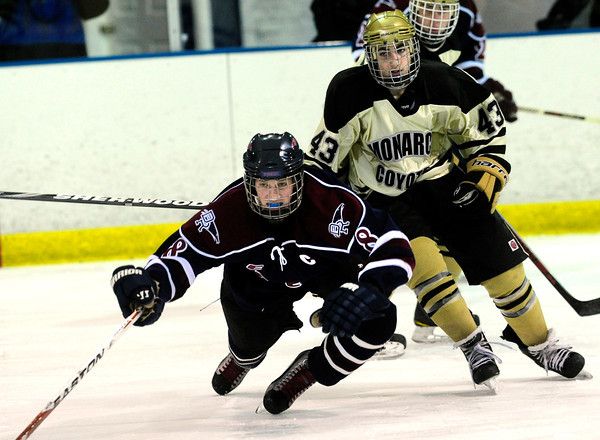 "Monarch High School Hockey Team's Gian Cervo (43) knocks down  Dakota Ridge's Ross Brauer (8)during their game at the Boulder Valley Ice rink in Superior on Monday January 23, 2012. For more photos and a recap of the game go to  <a href=""http://www.bocopreps.com"">http://www.bocopreps.com</a>. <br /> Photo by Paul Aiken"