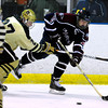 "Monarch High School Hockey Team's Everett Freske (27) tries to slow down Dakota Ridge's Zach Czarnecki (26) during their game at the Boulder Valley Ice rink in Superior on Monday January 23, 2012. For more photos and a recap of the game go to  <a href=""http://www.bocopreps.com"">http://www.bocopreps.com</a>. <br /> Photo by Paul Aiken"