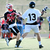 "Monarch High School's Connor Eakes (13) defends against Fairview High School's Wesley Carothers (24) during their game at Monarch High School on Tuesday April 10, 2012<br /> For more photos of the game go to  <a href=""http://www.bocopreps.com"">http://www.bocopreps.com</a>.<br /> April 10, 2012.<br /> Photo by Paul Aiken / The Camera"