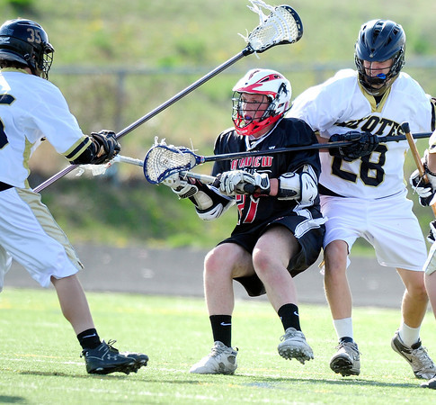 """Monarch High School's Gus Sawicki (28) defends Fairview High School's Austin Davie (27) during their game at Monarch High School on Tuesday April 10, 2012<br /> For more photos of the game go to  <a href=""""http://www.bocopreps.com"""">http://www.bocopreps.com</a>.<br /> Photo by Paul Aiken / The Camera"""