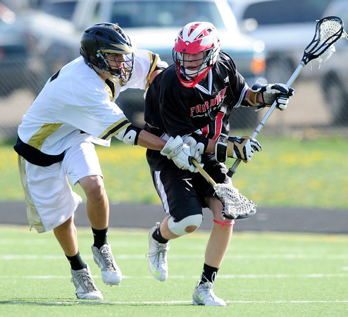 """Monarch High School's Max Weisner (5) defends against Fairview High School's Alex Brussell (17) during their game at Monarch High School on Tuesday April 10, 2012<br /> For more photos of the game go to  <a href=""""http://www.bocopreps.com"""">http://www.bocopreps.com</a>.<br /> April 10, 2012.<br /> Photo by Paul Aiken / The Camera"""
