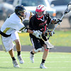 "Monarch High School's Max Weisner (5) defends against Fairview High School's Alex Brussell (17) during their game at Monarch High School on Tuesday April 10, 2012<br /> For more photos of the game go to  <a href=""http://www.bocopreps.com"">http://www.bocopreps.com</a>.<br /> April 10, 2012.<br /> Photo by Paul Aiken / The Camera"