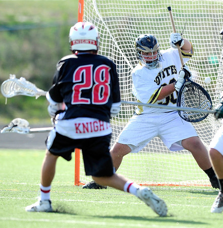 "Monarch High School's goalie Connor Johnson (30) can't stop a shot by Fairview High School's Charlie Beckman (28) during their game at Monarch High School on Tuesday April 10, 2012<br /> For more photos of the game go to  <a href=""http://www.bocopreps.com"">http://www.bocopreps.com</a>.<br /> Photo by Paul Aiken / The Camera"