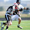 "Monarch High School's Gus Sawicki (28) defends against Fairview High School's Austin Davie (27) during their game at Monarch High School on Tuesday April 10, 2012<br /> For more photos of the game go to  <a href=""http://www.bocopreps.com"">http://www.bocopreps.com</a>.<br /> April 10, 2012.<br /> Photo by Paul Aiken / The Camera"