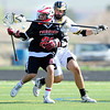 "Monarch High School's Elliot Whiehead (27) knocks the ball loose as he defends against Fairview High School's Charlie Beckman (28) during their game at Monarch High School on Tuesday April 10, 2012<br /> For more photos of the game go to  <a href=""http://www.bocopreps.com"">http://www.bocopreps.com</a>.<br /> April 10, 2012.<br /> Photo by Paul Aiken / The Camera"