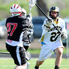 "Monarch High School's Elliot Whitehead (27) defends against a pass by  Fairview High School's Austin Davie (27) during their game at Monarch High School on Tuesday April 10, 2012<br /> For more photos of the game go to  <a href=""http://www.bocopreps.com"">http://www.bocopreps.com</a>.<br /> <br /> Photo by Paul Aiken / The Camera"