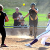 "Monarch High School's  Ashley Clark (17) waits for a throw from teammate Christina Rhodie (24) as  Holy Family  High School's Macy Cox (10) slides safely home during their softball game at Monarch High School on Tuesday September 4, 2012.<br /> For more photos go to  <a href=""http://www.bocopreps.com"">http://www.bocopreps.com</a><br /> Photo by Paul Aiken /"