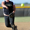 """Monarch High School's Ashley Clark ( 17) fires the ball home against Holy Family High School during their softball game at Monarch High School on Tuesday September 4, 2012.<br /> For more photos go to  <a href=""""http://www.bocopreps.com"""">http://www.bocopreps.com</a><br /> Photo by Paul Aiken /"""