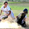 "Monarch High School's  Molly Nelson (14) slides safely past Holy Family  High School's  Moriah Turney (4) during their softball game at Monarch High School on Tuesday September 4, 2012.<br /> For more photos go to  <a href=""http://www.bocopreps.com"">http://www.bocopreps.com</a><br /> Photo by Paul Aiken /"
