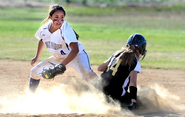 """Monarch High School's  Molly Nelson (14) slides safely past Holy Family  High School's  Moriah Turney (4) during their softball game at Monarch High School on Tuesday September 4, 2012.<br /> For more photos go to  <a href=""""http://www.bocopreps.com"""">http://www.bocopreps.com</a><br /> Photo by Paul Aiken /"""