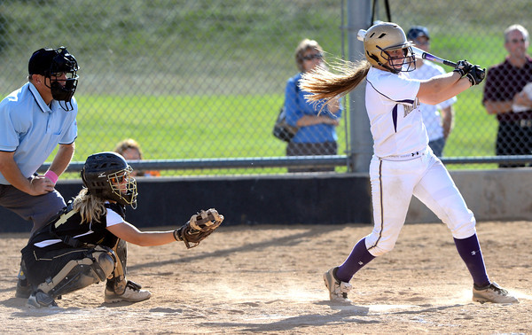 """Legacy High School's Sam Pinto (2) raps out a base hit against  Monarch during their softball game at Monarch High School on Tuesday September 4, 2012.<br /> For more photos go to  <a href=""""http://www.bocopreps.com"""">http://www.bocopreps.com</a><br /> Photo by Paul Aiken /"""