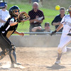 "Monarch High School's Christina Rhodie (24) waits for a throw as (18) Holy Family High School's Haley Draudt (1) slides in safely to home plate  during their softball game at Monarch High School on Tuesday September 4, 2012.<br /> For more photos go to  <a href=""http://www.bocopreps.com"">http://www.bocopreps.com</a><br /> Photo by Paul Aiken /"