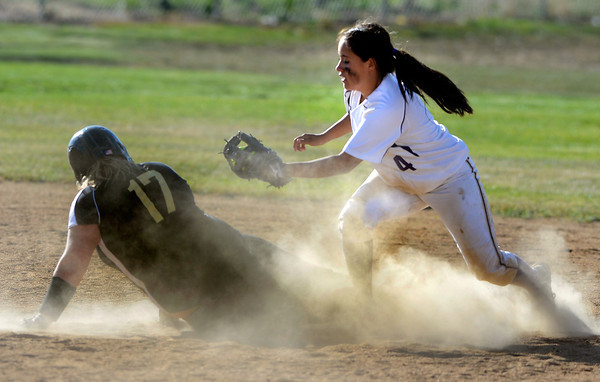 """Monarch High School's  Ashley Clark ( 17) slides safely past Holy Family  High School's  Moriah Turney (4) on a double during their softball game at Monarch High School on Tuesday September 4, 2012.<br /> For more photos go to  <a href=""""http://www.bocopreps.com"""">http://www.bocopreps.com</a><br /> Photo by Paul Aiken /"""